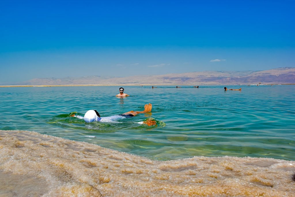 Floating on the surface of Dead Sea